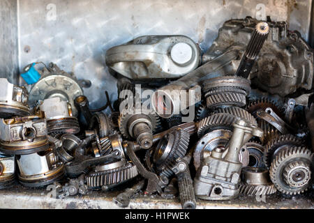 on the shelf are out of order old car engine parts - Stock Photo