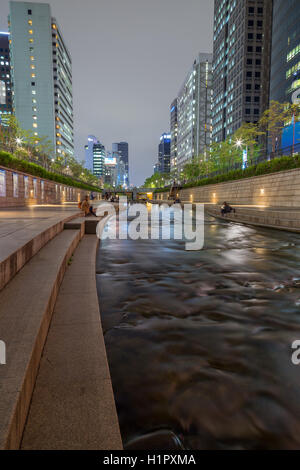 Few people along the Cheonggyecheon Stream in Seoul, South Korea in the evening. - Stock Photo
