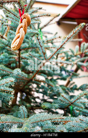 Part of the Christmas tree decorated with cookies pictured at the streets of old Riga in Latvia. It is considered - Stock Photo