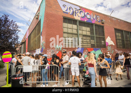 Thousands of millennials descend on the Bushwick neighborhood of Brooklyn to take in the experiential 29 Rooms installation - Stock Photo