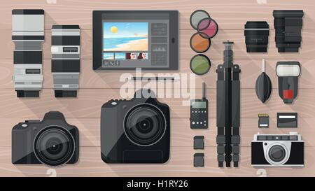 Professional photographer equipment on a desk, shooting and photo editing concept, flat lay - Stock Photo