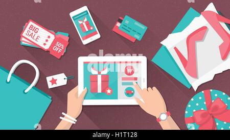 Online shopping and delivery concept, woman buying fashion products from an e-shop using a digital touch screen - Stock Photo