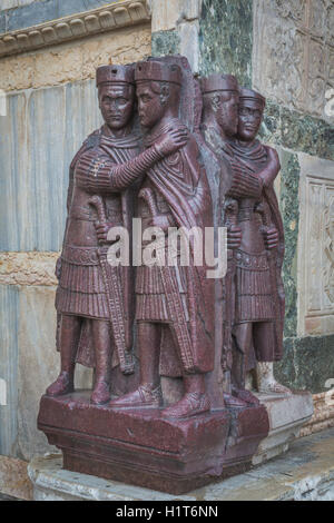 Venice, Venice Province, Veneto Region, Italy.  Porphyry sculpture group outside St Mark's Basilica of four Roman - Stock Photo