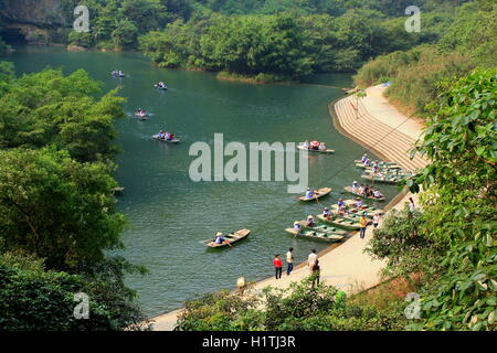 Ninh Binh, Vietnam - March 29, 2010: Ferry is parking at a pier for tourists visiting the Trang An Eco-Tourism Complex, - Stock Photo