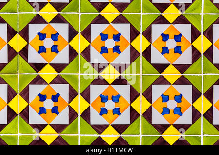 green, yellow and brown colored azulejos - tiles from Lisbon, Portugal - Stock Photo