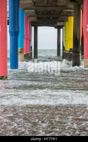 The colorful pillars of Scheveningen Pier near The Hague in the Netherlands - Stock Photo