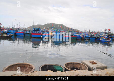 Nha Trang, Vietnam – February 21, 2013: Many fishing boat are parking at the Hon Ro seaport in Nha Trang city - Stock Photo