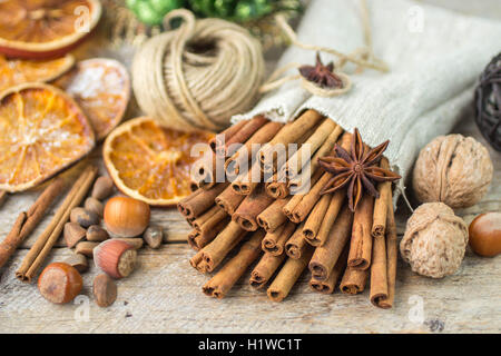Cinnamon sticks, star anise and nuts on an old wooden table. New year and Christmas compositions. Selective focus - Stock Photo