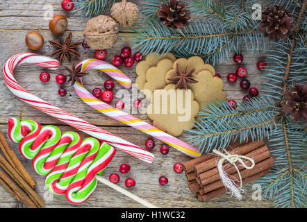 Composition for Christmas and New year -   walnuts, hazelnuts, candies, meringue, cookies, cranberry, cinnamon and - Stock Photo