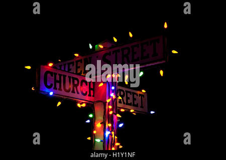 Street signs in Christmas lights - Stock Photo