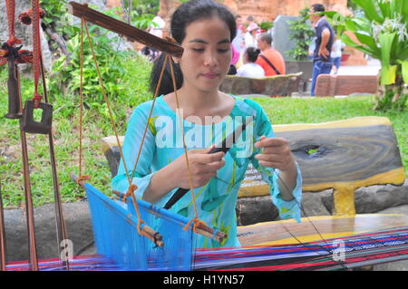 Nha Trang, Vietnam - July 11, 2015: A girl is performing the Champa textile technique at the Po Nagar temple in - Stock Photo