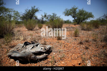 Weathered backpack left behind by a migrant in the Sonoran Desert between the USA and Mexico - Stock Photo