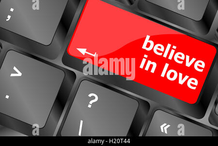 keyboard key with believe in love text and arrow - Stock Photo