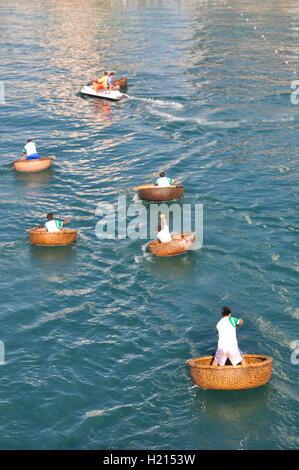 Nha Trang, Vietnam - July 14, 2015: Fishermen are racing by basket boats in the sea of Nha Trang bay - Stock Photo