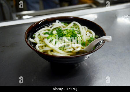 Kake udon noodles or noodle soup Japanese style for sale in restaurant in Osaka, Japan - Stock Photo