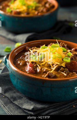 Homemade Beef Chili Con Carne with Cheese and Onions - Stock Photo