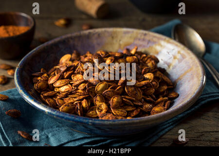 Homemade Roasted Spicy Pumpkin Seeds with Chili and Paprika - Stock Photo