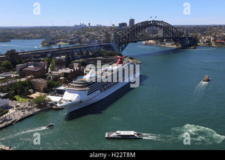 Aerial view of ferries departing from Circular Quay and Cruise Ship berthed at Overseas Passenger Terminal Sydney - Stock Photo