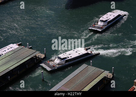 Aerial view of rivercat Parramatta class ferries arriving and departing from Circular Quay ferry terminal Sydney - Stock Photo