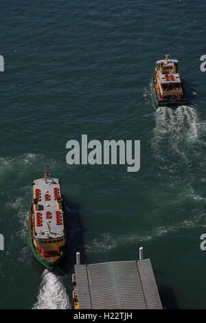 Aerial view of Sydney Harbour Ferries departing from Circular Quay Terminal Sydney CBD New South Wales Australia - Stock Photo