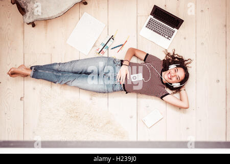Adolescente listening to music. - Stock Photo