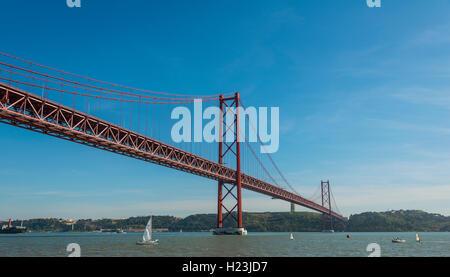 Ponte 25 de Abril, 25th of April Bridge, River Tagus, Lisbon, Lisboa Region, Portugal - Stock Photo