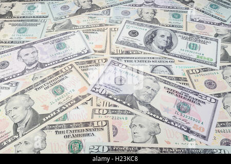 Various US dollar bills in a pile - Stock Photo