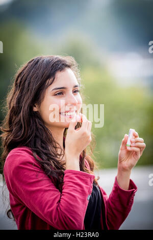 Woman taking homeopathic medicine. - Stock Photo