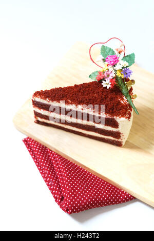 Strawberry cake, Red velvet sliced cake on wooden plate.Selective focus on cake and isolated on white background. - Stock Photo
