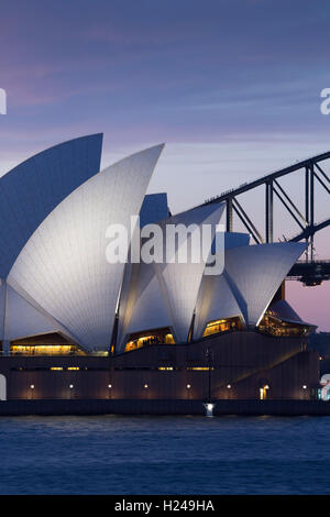 Sunset over the Sydney Opera House and Harbour Bridge from Mrs Macquaries Point Sydney Australia - Stock Photo