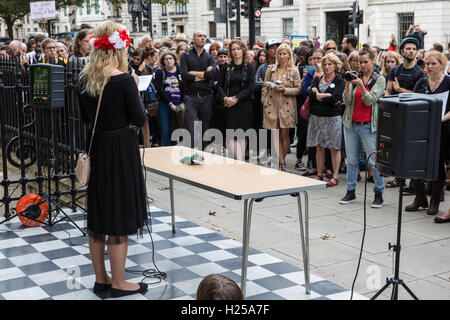 London, UK. 24th Sep, 2016. A speaker from a Polish women's group speaks at a 'black protest' outside the Polish - Stock Photo