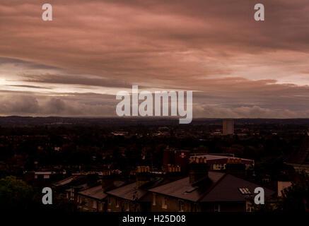 Wimbledon London, UK. 25th September 2016. UK Weather: Sunrise in Wimbledon with dramatic storm clouds Credit:  - Stock Photo