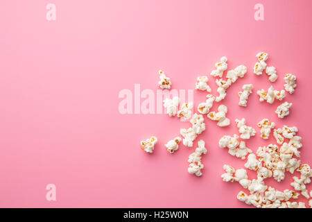 The popcorn on pink background. - Stock Photo