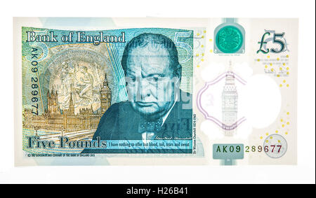 The New Polymer UK Five Pound Note with Winston Churchhill on a white background - Stock Photo