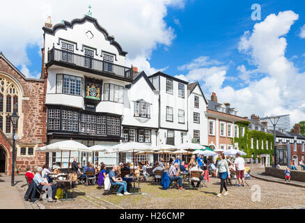 Tourists sitting outside Mols Coffee house cafe Cathedral Close Exeter Devon England UK GB EU Europe - Stock Photo