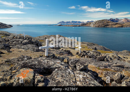 Graves marked by white crosses, Kulusuk, East Greenland - Stock Photo