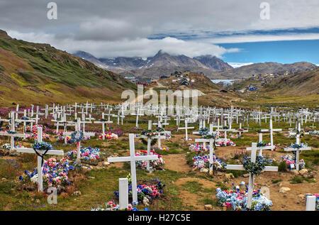 Cemetery outside town of Tasiilaq on Ammassalik Island, East Greenland - Stock Photo