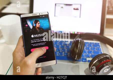 CHIANG MAI,THAILAND - Sept 25,2016: A man hand holding screen shot of Apple music app showing on Android. Apple - Stock Photo