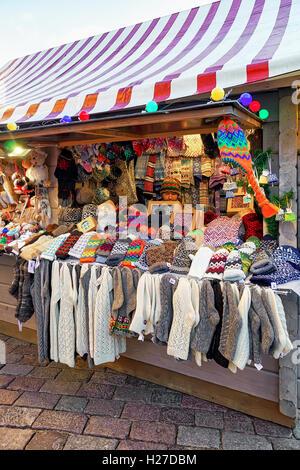 Riga, Latvia - December 25, 2015: One of the stalls at the Christmas Market in Riga, Latvia. The market is full - Stock Photo