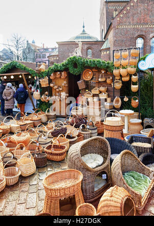 Riga, Latvia - December 25, 2015: One of the stalls with wicker baskets in various shapes and sizes displayed during - Stock Photo