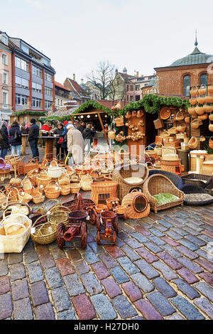 Riga, Latvia - December 25, 2015: Street with lots of wicker baskets displayed for sale at one of the stalls during - Stock Photo