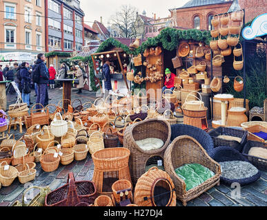 Riga, Latvia - December 25, 2015: One of the stalls with different straw baskets and other products at the Christmas - Stock Photo
