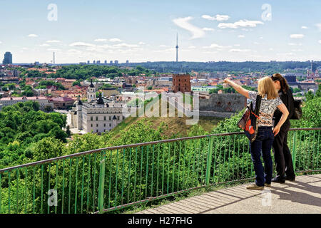 Vilnius, Lithuania - June 13, 2016: Women viewing the Gediminas Tower on the hill and Lower Castle down the hill, - Stock Photo