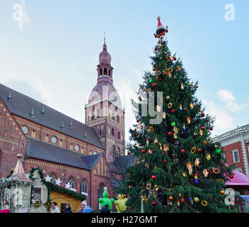 Riga, Latvia - December 25, 2015: People at the Christmas tree at the Christmas market in the Dome square in the - Stock Photo