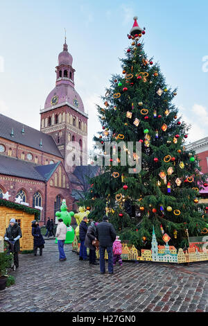 Riga, Latvia - December 25, 2015: People near Christmas tree at the Christmas market in the Dome square in the center - Stock Photo