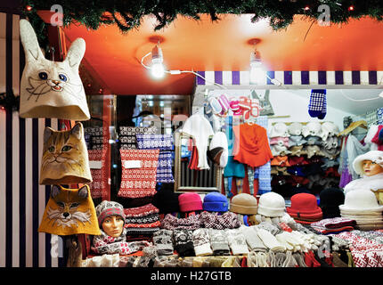 Warm colorful hats, mittens, gloves and socks at one of the stalls at the street Christmas Market in Riga, Latvia. - Stock Photo
