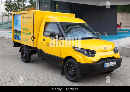 New electric mail delivery van from the Deutsche Post DHL - Stock Photo