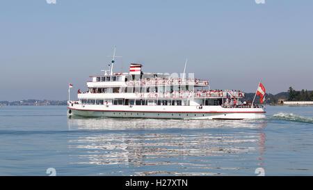 Pleasure passenger craft passing Friedrichshafen on Lake Constance in Germany - Stock Photo