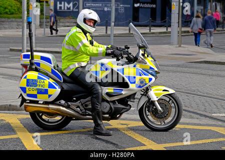 Irish Patrol cop Garda motorcyclist traffic Corps Honda Deauville, Dublin Ireland - Stock Photo