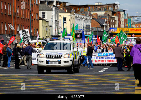 Right To Water campaigners marching in Dublin Ireland in 2016, lead by a police vehicle, Garda Car. - Stock Photo